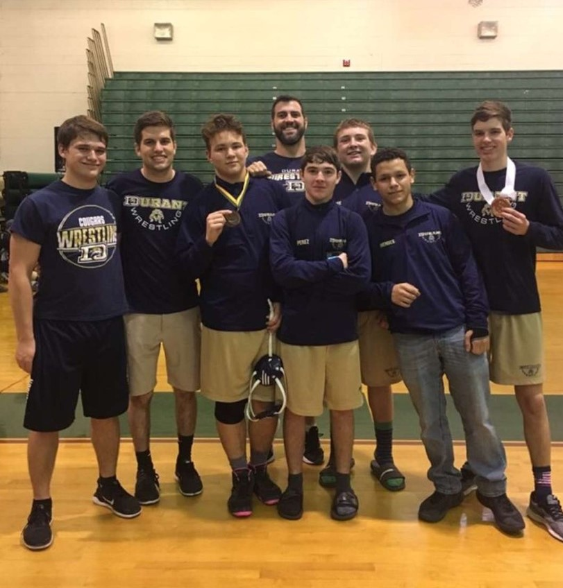 The wrestling team gathers to celebrate their camaraderie in anticipation for the upcoming season.