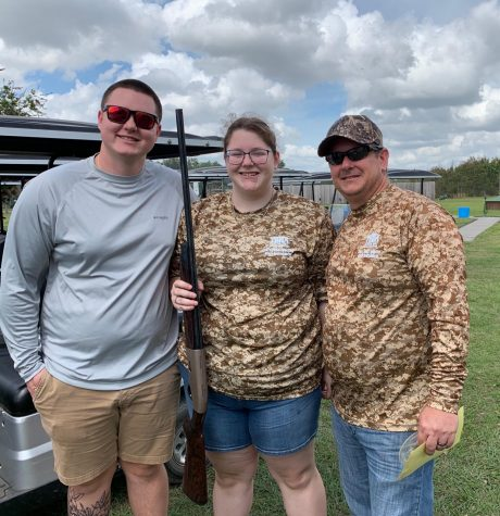 Hailey McKean (center) is a student at Durant, heavily involved in clay shooting.