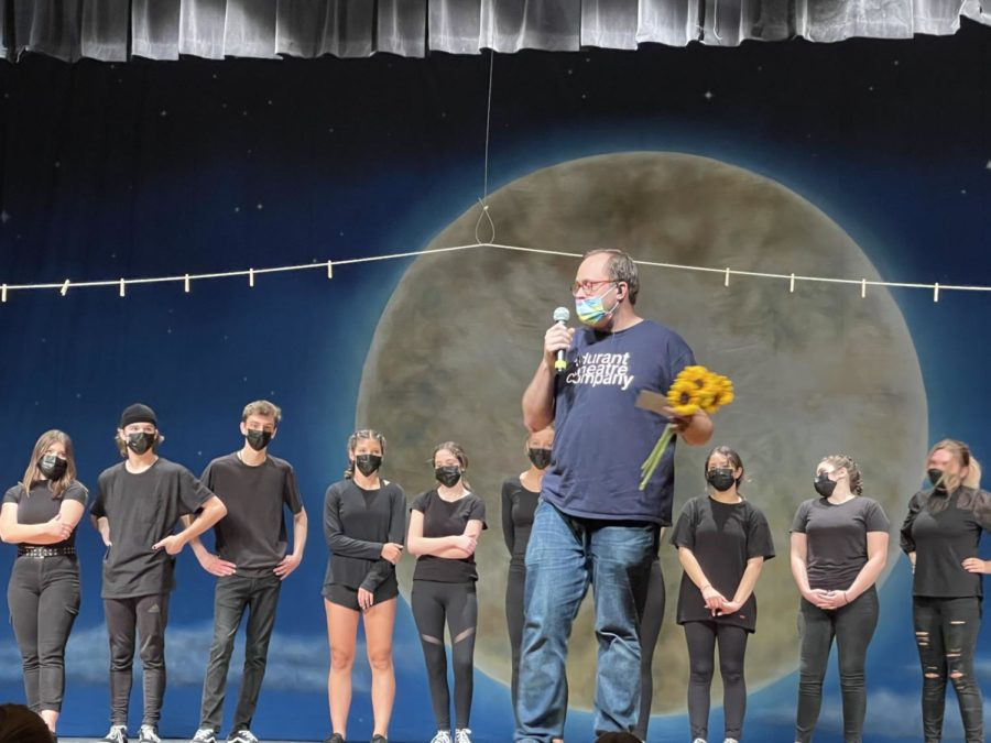 Director Stephen Arment hands out sunflowers to the graduating senior of the Durant Theatre Company