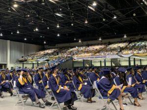 Durant graduates wait to receive their high school diplomas.